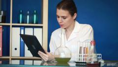 Female chemist using tablet computer in laboratory Stock Footage