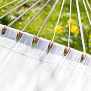 Vacant hammock in green and sunny garden Stock Photos