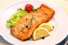 Grilled salmon filet and vegetables Stock Photos