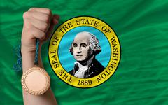 Stock Photo of bronze medal for sport and  flag of american state of washington