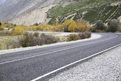 rotate the asphalt road in the mountains - stock photo