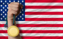 Gold medal for sport and  national flag of america Stock Photos