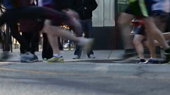 View of runners' shoes as they quickly pass by Stock Footage