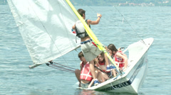 Children falling in the water while practicing sailing - stock footage