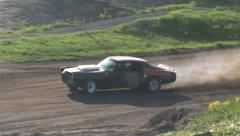 Old Chevrolet Camaro joyride on a gravel path Stock Footage