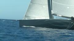 Sailing boat navigating fast during regatta - stock footage