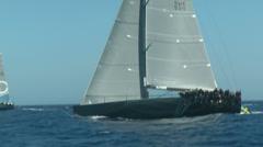 Sailing boats navigating fast during regatta - stock footage