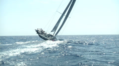 Sailing boat navigating fast during regatta - stock footage