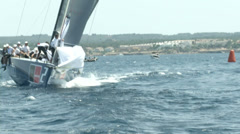 Crew of sailing boat maneuvering during regatta Stock Footage