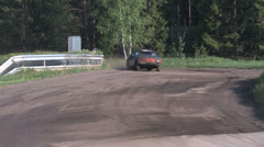 Competition with scrap cars on a gravel path Stock Footage