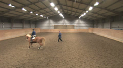 Riders taking lessons at a riding school camps Stock Footage