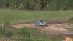 Scrap car running on a gravel path Stock Footage
