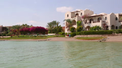 View of houses and hotels from boat floating on channels of El Gouna - Egypt Stock Footage
