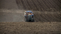 Farmers and laborers of the field planting potatoes in the soil with machinery Stock Footage