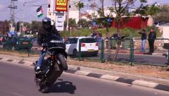 Motorcyclist with Palestinian flag during Land Day Commemoration - stock footage