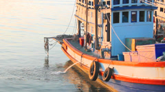Fishing boats moored at the dock discharge, full HD. - stock footage