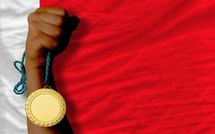 Stock Photo of gold medal for sport and  national flag of bahrain