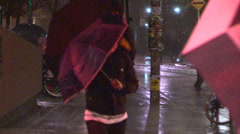 College and university student heading home in wild wind and rain storm Stock Footage