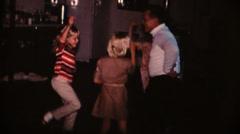 60's  vintage, Grandpa teaching girls dance - stock footage