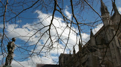 Moving through trees at Winchester Cathedral Stock Footage