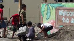 Children shovel sand Stock Footage