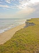 spectacular landscape view of a lonely beach with big cliffs in the atlantic - stock photo