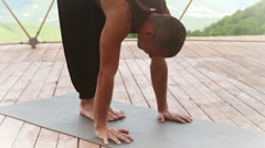 Yoga man Handstand pose in mountain training center Stock Footage