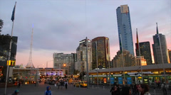 A vibrant colored sunset pan from federation square of the south yarra skyline Stock Footage