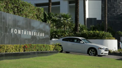 MIAMI FONTAINEBLEU car coming out boatshow Stock Footage
