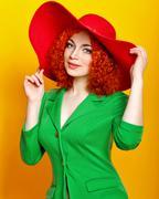 Girl in shady hat Stock Photos