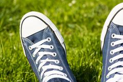 Retro Sneakers On Green Grass - stock photo