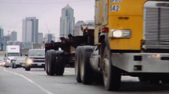 Yellow Truck passing by on highway with Seattle skyline in the background Stock Footage