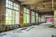 Big windows in old abandoned factory hall Stock Photos