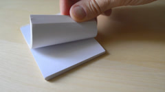 Man flipping pages of small book - stock footage