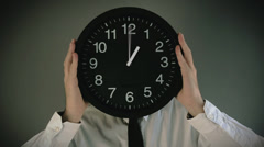 Time management. Businessman with clock in front of his head - stock footage