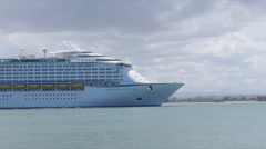 Cruise ship passing by in transit in harbor Stock Footage