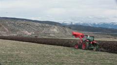 Farmer plow field mountain valley HD 2466 Stock Footage