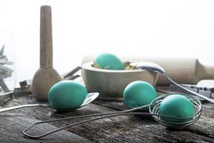 teal easter eggs with spoons - stock photo