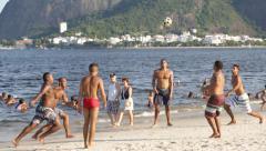 Men Play Soccer Football Game on the Beach - Rio de Janeiro - Brazil Stock Footage