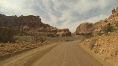 BEAUTIFUL DRIVE AROUND RED, SANDSTONE BUTTES IN THE DESERT Stock Footage
