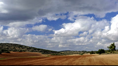 Brown fields with blue sky and clouds, time lapse, Israel Stock Footage