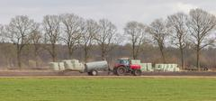 Application of manure on arable Stock Photos