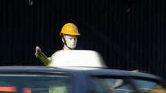 Dummy Traffic controller warning drivers of construction site Stock Footage