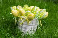 Stock Photo of easter eggs in white pail on grass