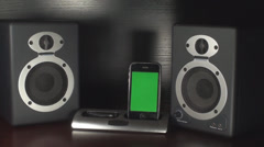 Smartphone With Green Screen In A Dock Playing Music, Speakers, Bass, Reflex Stock Footage