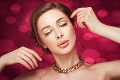 beautiful girl with a gold chain. - stock photo