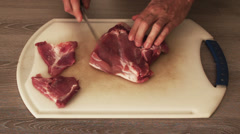 Chef cutting steak onto thin slices; close up Stock Footage
