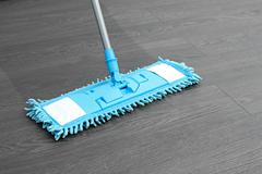 House cleaning - mop washing wooden floor Stock Photos