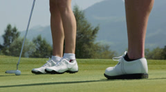 Close-up of female golfer putting a golfball - stock footage
