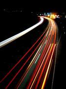 Lights of evening traffic Stock Photos